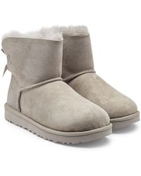 UGG - Mini Bailey Bow Shearling Lined Suede Boots - Lyst
