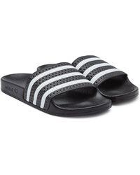 a3206967f26d60 Lyst - adidas Originals Adilette Textured-rubber Slides in Black for Men