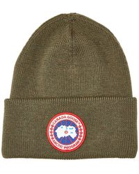 9e0687c6d07 Lyst - Canada Goose Pompom-embellished Wool Beanie Hat in Red