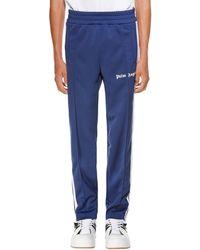 Palm Angels Pantaloni sportivi con banda laterale - Blu