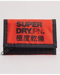 Superdry Cartera plegable de tres compartimentos con logo - Naranja