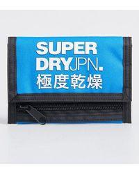 Superdry Cartera plegable de tres compartimentos con logo - Azul