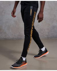 Superdry - Gym Tech Gold Award Joggers - Lyst