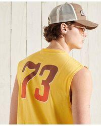 Superdry Camiseta de tirantes con gráfico, diseño recortado y estilo boho - Amarillo