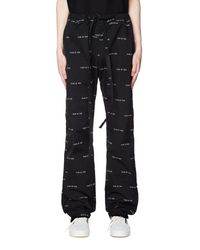 Fear Of God All Over Logo Printed Baggy Trousers - Black