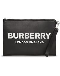 Burberry Black Leather Clutch With Logo Printed In White On The Front And Wrist Strap