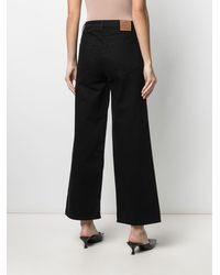 Totême Flare Fit Wide-leg Jeans - Black