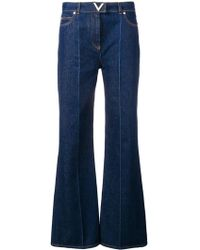 Valentino - Cotton Flare Denim Jeans - Lyst