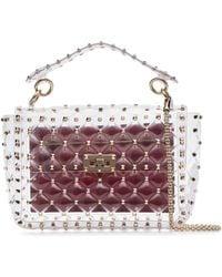 a5fa2774148e Lyst - Valentino Rockstud Small PVC Lock Crossbody Bag