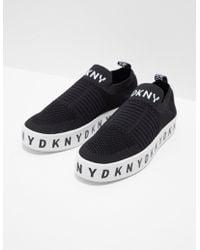 2307cd6d17c Lyst - DKNY Banner Bow Slip On Sneakers - Black in Black