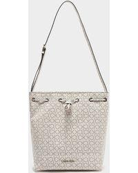 Calvin Klein Monogram Print Bucket Bag White
