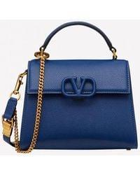 Valentino Vsling Grainy Calfskin Top Handle Bag With Signature Vlogo - Blue
