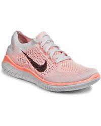 Nike | Free Run Flyknit Sneaker | Lyst