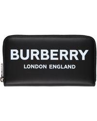 Burberry Portafogli in pelle nera chiuso da zip integrale con logo stampato in bianco sul davanti. - Nero