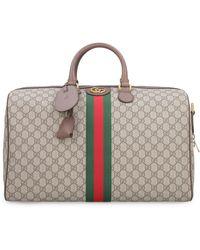 Gucci Borsa da viaggio Ophidia in tessuto GG supreme - Neutro