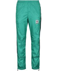Off-White c/o Virgil Abloh Track-pants in nylon con logo - Verde