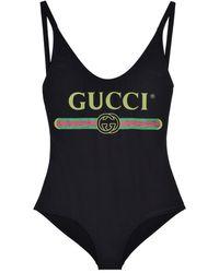 Gucci Costume intero nero con logo vintage