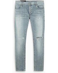 Balmain - Jeans skinny strappati - Lyst