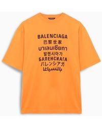 Balenciaga T-shirt logo multi lingua arancione - Nero