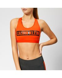 be47498159c4f Lyst - Calvin Klein Performance Printed Halter Neck Racerback Sports Bra