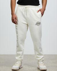 Mitchell & Ness Tonal Bleach Logo Tracks - White