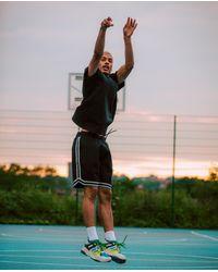 The Kooples Schwarze Basketballshorts aus Neopren mit NBA