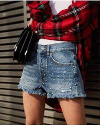 The Kooples Pantalones cortos azules de denim con tachuelas