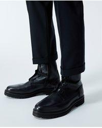 The Kooples Boots schwarz Lederdetail Schnürung seitlich