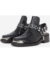The Kooples Mules cuir noires détail western amovible