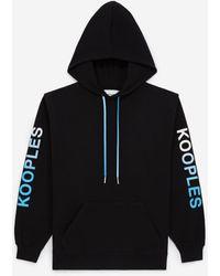 The Kooples Zwarte Sweater Met Capuchon Logo Op De Mouwen