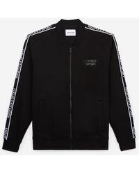 The Kooples Zwarte Sweater Met Rits Teddy En Logoband