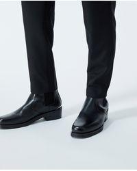 The Kooples Zwarte Chelsea Boots Met Verouderd Leereffect
