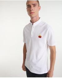 The Kooples Polo coton blanc logo brodé flamme