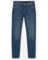 The Kooples Vintage-Jeans im Destroy-Stil mit Lederlogo - Blau