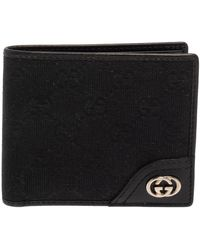 Gucci - Black GG Canvas And Leather GG Interlocking Bifold Wallet - Lyst
