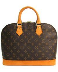 99b85e1fa617 Lyst - Louis Vuitton Monogram Canvas Tikal Gm Bag in Brown