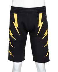 Neil Barrett Black & Yellow Slouch Fit Thunderbolt Shorts