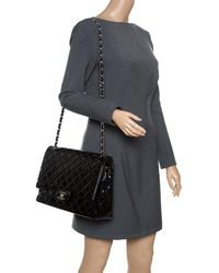 bdf5940bccf4d3 Chanel - Black Quilted Patent Leather Maxi Classic Double Flap Bag - Lyst