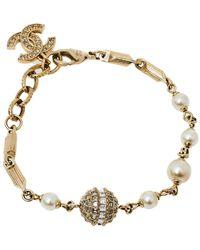 Chanel Gold Tone Crystal Ball And Cc Charm Bracelet - Metallic