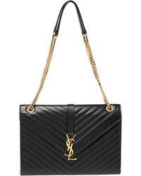 Saint Laurent Saint Laurent Black Matelasse Leather Large Cassandre Flap Bag