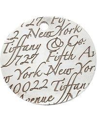 Tiffany & Co. Tiffany Notes Fifth Avenue New York Engraved Circular Silver Pendant Charm - Metallic