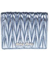 Miu Miu - Metallic Blue Matelasse Leather Flap Compact Wallet - Lyst