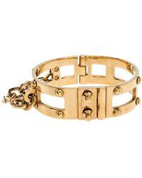 Louis Vuitton Lock Me Frame Gold Tone Cuff Bracelet - Metallic