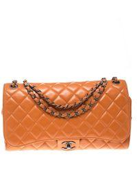 Chanel Orange Leather Drawstring Flap Shopping Bag