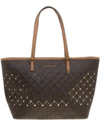 0a99c7ed9f Lyst - Michael Michael Kors Jet Set Logo Perforated Tote Bag in White