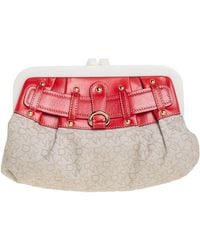 DKNY Beige/orange Signature Canvas And Leather Kisslock Frame Clutch - Natural
