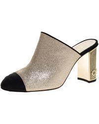 Chanel Gold/black Glitter Leather Cc Cap Toe Mules - Metallic