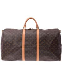 9ca791a40fc3 Lyst - Louis Vuitton Keepall 55 Bandouliere Travel Bag - Vintage in ...