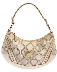 Versace Gold Monogram Canvas And Leather Studded Hobo - Metallic