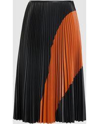 Cedric Charlier Pleated Colour-block Eco-leather Midi Skirt - Black